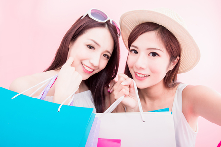 two shopping woman selfie happily on the pink background