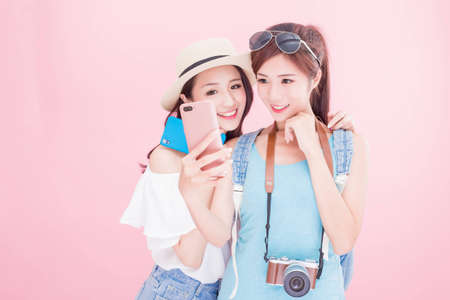 two beauty woman selfie happily and go on the travel