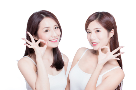 two beauty skincare woman show ok to you on the white background Stock Photo