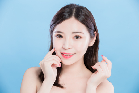 Beauty skincare woman look you and smile happily on the blue background Stock Photo