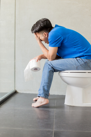 man feel pain with constipation in wc