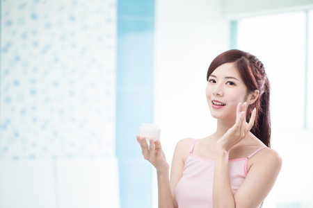 beauty woman with moisturizer concept in the bathroom Banque d'images