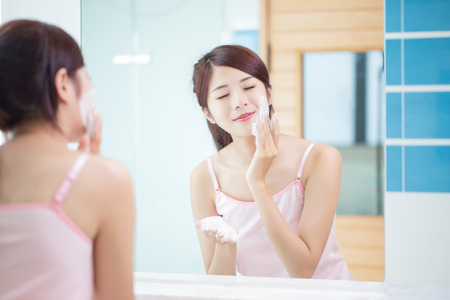 beauty woman clean her face in the bathroom