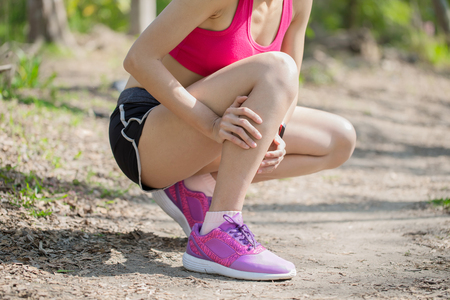 sport woman feel pain with calf strain in the forest