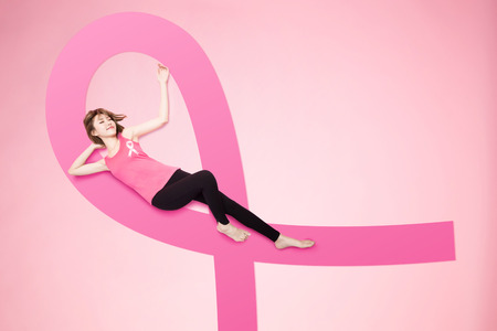 woman lying on floor and feel relax with prevention breast cancer concept Standard-Bild - 109099796
