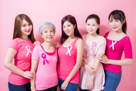 women with cancer prevention on the pink background