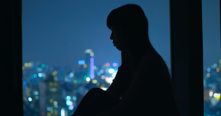 woman sit and feel depression at night