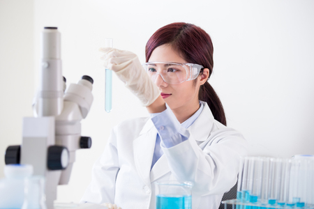 woman scientist take test tube in the laboratory Stock Photo