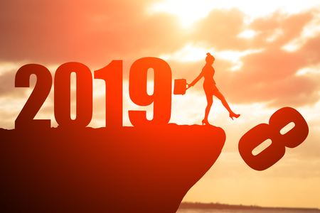 silhouette of businesswoman on the moutain with 2019 Stock Photo