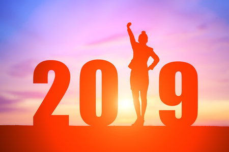 silhouette of business woman feel excited with 2019 year Stok Fotoğraf
