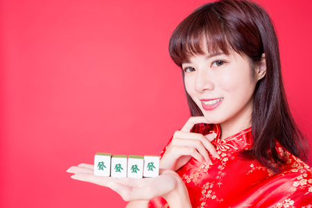 beauty woman wear cheongsam and show mahjong to you - Rich text on girl hand in Chinese words