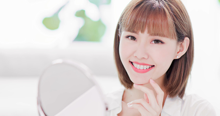 Beauty woman smile to you with the brace retainer for tooth Stock Photo