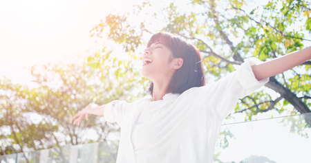 young woman feel carefree and take a deep breath at nature outdoor 版權商用圖片