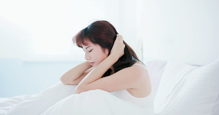 Young woman has a trouble sleeping and feel unhappy in the morning 스톡 콘텐츠