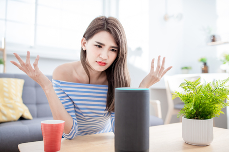 Smart AI speaker Error - Young Woman angry because voice assistant can not recognize her language Stock fotó