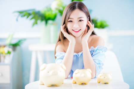 Happy woman with her golden piggy bank and feel happy at home