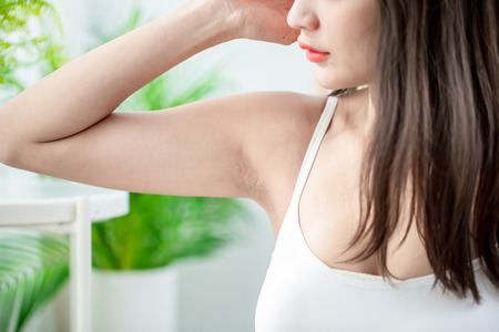 Young beauty young woman with under armpit problem Stockfoto - 121110956