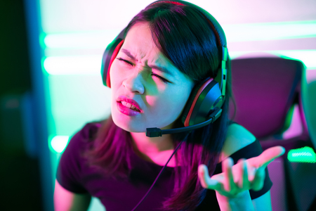 Young asian esport gamer girl feel angry while playing in Online Video Game because of internet is down