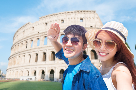 couple selfie happily with Colosseum in Italy