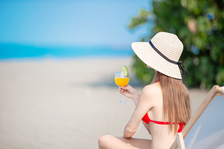 beauty asian woman have sunbathing with juice in the summer