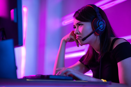 Young asian esport gamer girl feel angry while playing in Online Video Game because of internet is down 스톡 콘텐츠