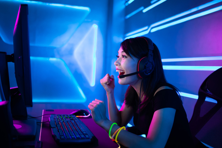 Young Asian Pretty Pro Gamer win in Online Video Game