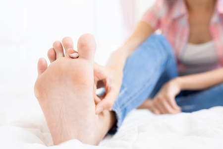 woman applying cream for athletes foot treatment