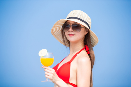 Beauty asian woman enjoy the sunshine with juice in the summer Stock Photo