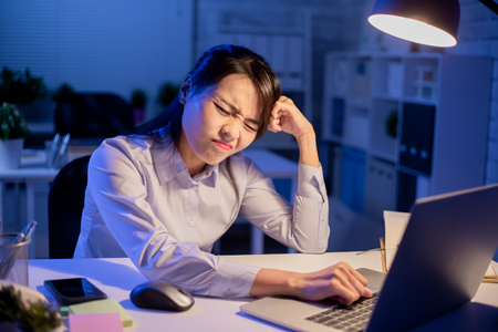 Asian woman overtime work and had headache pain in the office
