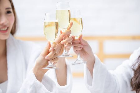 Smiling women friend with champagne in the spa salon or hotel Stok Fotoğraf