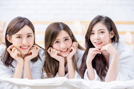 Three Smiling asian women with bathrobe and they smile to you Stok Fotoğraf