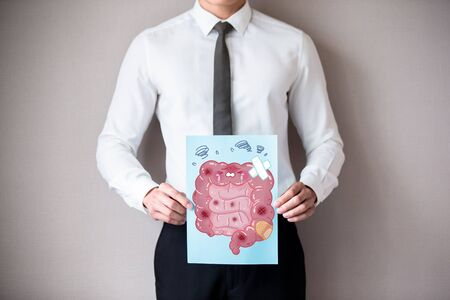 asian businessman with unhealthy intestine and feel worry