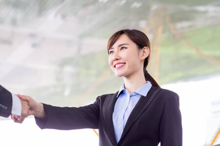 Businesswoman handshake with confident smile after a meeting
