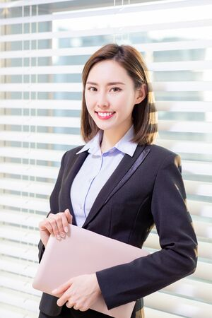 asian businesswoman look to you with confidence in the office