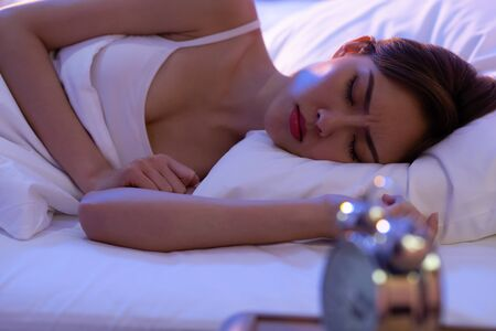 woman has insomnia or nightmare on the bed at night
