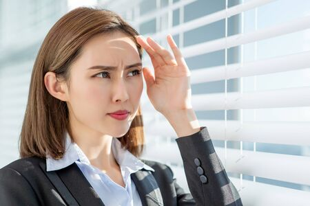 Young asian business woman dislike the sunshine because afraid of suntan
