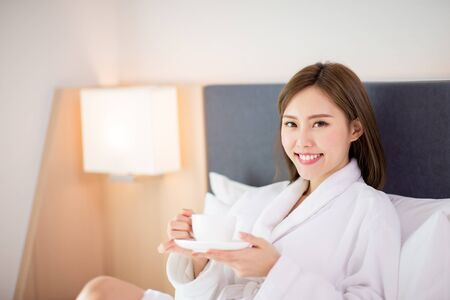 beauty asian woman drink coffee and enjoy a wonderful morning in the hotel