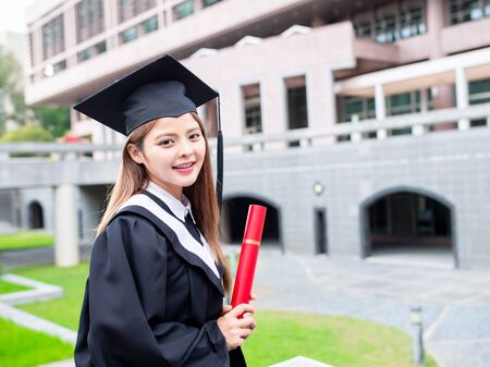 Girl gratuate smile happily at campus with diploma