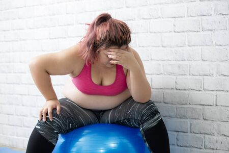 plus size asian girl feel upset when exercising Banco de Imagens