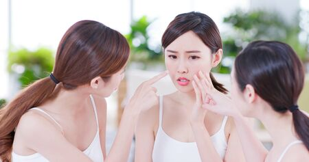 asian women friend are chat about the skin problem Stock Photo