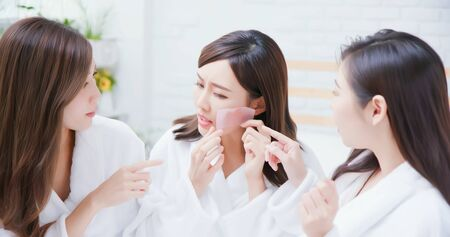 asian women put the oil absorbing paper on her face and feel bad