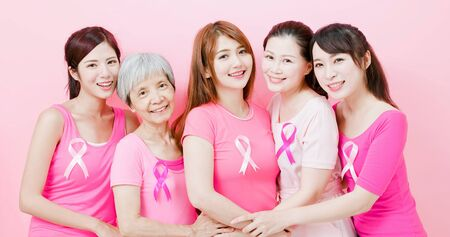 Women with breast cancer prevention and smile to you on the pink