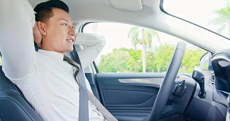 confident business asian man enjoy to drive an self-driving smart car 版權商用圖片