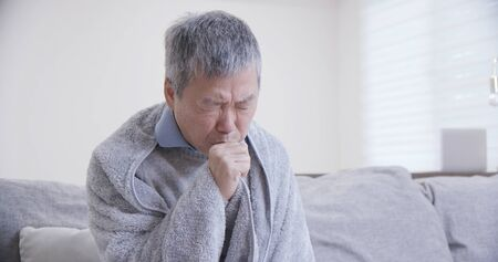 old asian man get a cold and cough at home