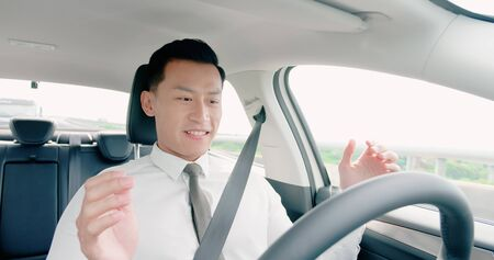 business asian man feel amazing and enjoy to drive an auto self-driving smart car in highway Foto de archivo - 129773819