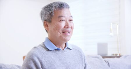 asian old man feel better at home after taking medicine