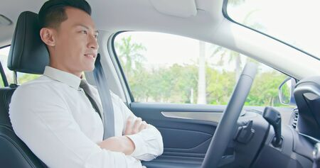 confident business asian man experience to drive an self-driving smart car Фото со стока
