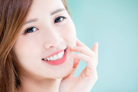 close up of beauty skin care woman touch her face and smile to you at home
