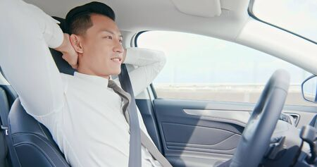 confident business asian man enjoy to drive an auto self-driving smart car in highway Stock fotó