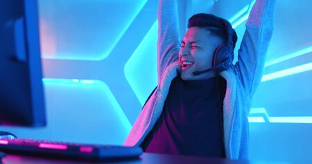 Young Asian Handsome Pro Gamer win in Online Video Game